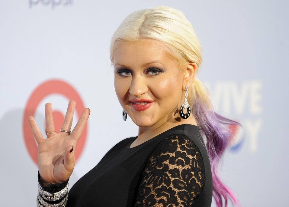 Singer and television personality Christina Aguilera arrives at the National Council of La Raza ALMA Awards in Pasadena, California, September 16, 2012. REUTERS/Gus Ruelas (UNITED STATES - Tags: ENTERTAINMENT)